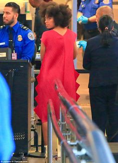 Unique style: Solange Knowles wore an unusual bright red dress to catch a flight at Los Angeles International Airport on Friday