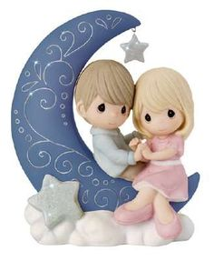 "For a love that is unmistakably out of this world, there is no measuring how far it stretches. With hands intertwined, this couple shares a sweet sentiment while perched upon a crescent moon. Together they convey how endless the bonds of true love really are while a bright and shining star sparkles overhead. Bisque porcelain. 6 3/4"" H."