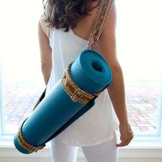 It can handle any mat you throw at it. Hand Appliquéd Ribbon Yoga Mat Sling. Shop new colors at renee-soulie.com