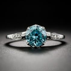 Blue Zircon and Diamond Solitaire Ring
