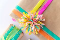 I love getting creative with my gift wrap.  I have a slight obsession with stocking up and buying all kinds of wrapping supplies.  I store up a bunch of wrapping paper, ribbon, tags, yarn, tissue paper, stickers and bows and then try to get creative with it all.  I bought the most amazing and bright tissue