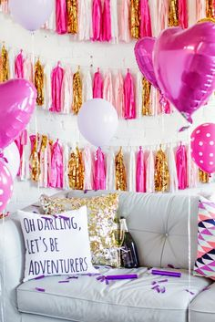 Cute pink, gold, and white tissue paper garland for a photo backdrop