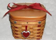 Longaberger Valentine Basket - I think this may be my all time favorite basket of my Longaberger Basket collection. It is such a sweet little basket and came with a liner that has a delicate floral pattern. :)