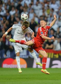 Bastian Schweinsteiger is challenged by Fabio Coentrão during the UEFA Champions League semi-final first leg match between Real Madrid CF and FC Bayern München at the Estadio Santiago Bernabéu on April 23, 2014 in Madrid, Spain.