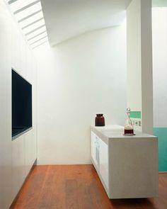 Mayfair Mews House, London. Kitchen with cantilevered stone island unit.. Gavin Jackson Architects.