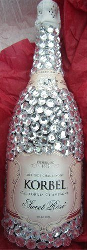 Bedazzled champagne bottle!Sarah will so do this to her wedding bottle!