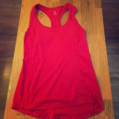 Zella Racerback Tank Racerback Zella tank size XS. Deep, beautiful color of red. Relaxed fit-not too tight, but not too loose. Looks brand new! Zella Tops Tank Tops