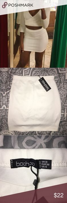 NWT White Bodycon Mini Skirt I originally ordered this to wear on my birthday but decided not to! Never worn! Still has tag! Perfect for a night out! Boohoo Skirts Mini