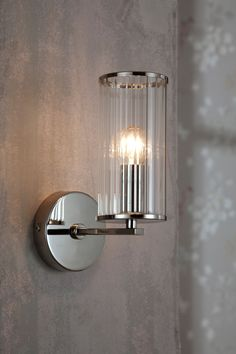 This wall light is designed with a softly reeded glass shade with polished chrome detailing. Glass Wall Lights, Bathroom Wall Lights, Reeded Glass, Home Lighting, Wall Lighting, Glass Panels, Polished Chrome, Glass Shades, Lamp Light