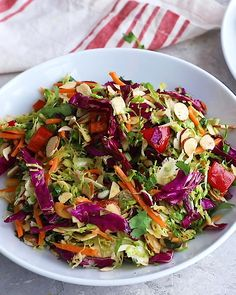 Delicious cashew crunch shredded brussels sprouts salad tossed in a flavorful sesame ginger dressing. This easy vegan salad recipe is loaded with colorful veggies and topped with crunchy roasted cashews and toasted almonds. Great for meal prep parties and Best Salad Recipes, Raw Food Recipes, Diet Recipes, Cooking Recipes, Healthy Recipes, Dinner Salad Recipes, Simple Salad Recipes, Best Vegan Salads, Vegan Quinoa Recipes