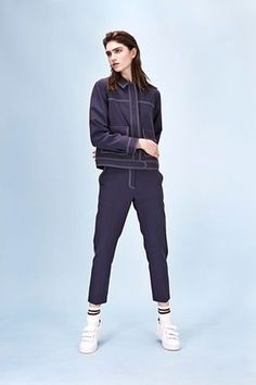 Jacket, £65, and trousers, £42, both topshop.com. Trainers, £209, sandro-paris.com. Socks, stylist's own.