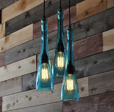 $425 This is a 3-Pendant chandelier made from 3 recycled tear drop shaped bottles that are hand cut and polished smooth. At 15 tall and 4 wide, they