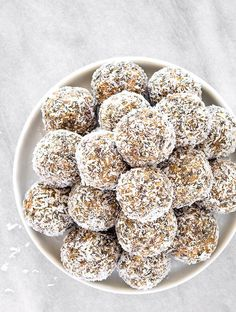 Healthy Lemon Coconut Energy Balls - Packed with raw cashew nuts, unsweetened shredded coconut, dates, chia seeds, and lemon, they are the perfect no bake snack or treat! Vegan, paleo, and gluten-free.