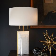 Sheets of white marble are framed by brass finished hardware on our Deco Marble Table lamp, for a glam look that's sure to steal the show on side tables, desks—even nightstands.