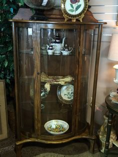 """This beautiful antique curved china cabinet with 3 glass shelves could be used in so many areas of your home! It would be beautiful in a dining room holding Grandma's china. It could also be used in a foyer holding collectibles or framed pictures of your family. Think about using it in a bathroom for extra storage or even in a family room to add that perfect piece of furniture to complete the room. Dimensions are 35"""" x 14"""" x 61"""". (we do not have the key to this piece)"""