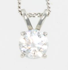 LOT 520S, A single stone brilliant cut diamond pendant set in a white gold mount, approx. 1ct on a platinum chain, colour G/H, clarity VS1 SOLD £1350