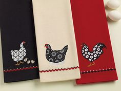 Hen & Chicks Black Embroidered Dishtowel, by DII. The Home to Roost Collection features a whimsical theme of chickens in a red, black, cream, and white color palette. This is for the Hen & Chicks Black Embroidered Dishtowel (the towel on the LEFT in the photo) - features an appliqued and embroidered chicken and little chicks on a black dishtowel. Measures 1...