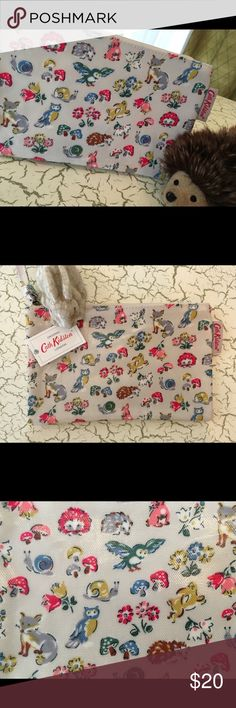 """Cath Kidston Forest Animals Zip Purse New with tags, this is a precious Cath Kidston Forest Animals Zip Purse. UK brand Cath Kidston designs whimsical pieces better than anyone and this little bag is no exception. The Forest Animals print features hedgehogs, bunnies, foxes, owls, snails, mushrooms and flowers on an ivory background. It measures 7.5"""" x 4.6"""" and .25"""" wide. Lots of uses:a small clutch (room for an iPhone, cash, credit cards and a lipstick or two), a pencil case, a small…"""