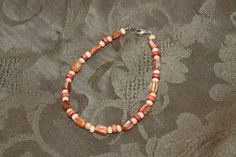 Orange Mother-of-Pearl Nuggets with Cream and Red Wooden Flat Rounds Bracelet