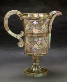 Ewer, Gujarat, ca. 1600  Wood core covered with mother-of-pearl, fixed by brass pins.   Height 23 cm  Peabody Essex Museum, Salem. Museum purchase, 2000