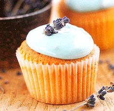For the cupcakes:      1 cup butter, softened      1 cup superfine sugar      2 cups self rising flour      4 eggs      1 teaspoon vanilla extract      For the Frosting:      1 cup cream cheese, softened      1 pound confectioners sugar      1/3 cup honey      blue food coloring      2 tablespoons dried lavender flowers