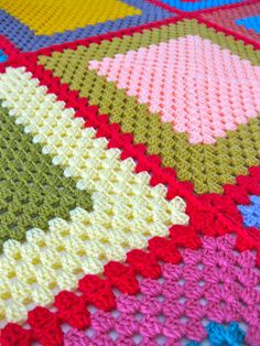 Bright and bursting with colour, my youngest claimed this blanket. One square a day, twelve in total, outlined in red and bordered in brown. A mix of 100% wool and acrylic!
