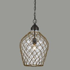 Featuring a textured bubble glass shade artfully wrapped in woven rope, our bell-shaped hanging pendant exudes a nautical appeal that brings to mind contemporary beach house living.