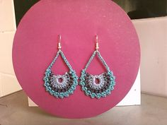 Crochet Earrings using a bookmark pattern. Follow the pattern links to get to the original pattern.