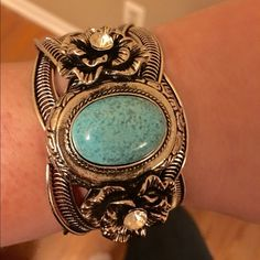 💖Host Pick 10/28💖Turquoise & Rose Silver Bangle 🆕 Gorgeous Silver Cuff with Roses accented in rhinestones. Beautiful genuine turquoise stone centered in braided band. 18 K plated. Lead & Nickel Free. It's a classic!! T&J Designs Jewelry Bracelets