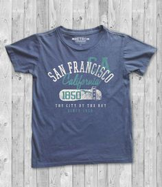 this is 100% original artwork San Francisco Golden Gate Bridge California Retro Vintage Silk Screen Print hand screen printed 2 color design. AVAILABLE IN S-XXL, IF YOU NEED A DIFFERENT SIZE PLEASE LET ME KNOW PRINTED ON BLUE JEAN • 6.1 oz., 100% heavyweight ringspun cotton garment dyed t-shirt • Soft washed garment dyed fabric available for $19.99 on etsy