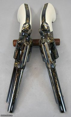 Colt Single-Action Army Revolvers, Gold Inlay and Pristine Bluing with Ivory Grips. Weapons Guns, Guns And Ammo, Armas Wallpaper, Colt Single Action Army, Cowboy Action Shooting, Revolver Pistol, Gun Holster, Holsters, Rifles