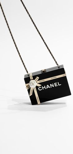 CHANEL. Minaudiere, brass, resin & light gold metal-black.