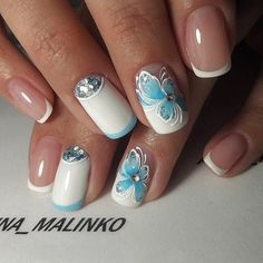 The Blue Butterflied White Nail Art Design. Enhance the look of your nails with this beautifully created white base with the blue butterfly nail art design. This is something new that you can try with your blue and white prom dress.