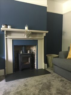 Farrow & Ball stiffkey blue with log burner and painted mantelpiece Navy Living Rooms, Blue Living Room Decor, Living Room Lounge, Blue Rooms, Living Room Paint, Living Room Interior, Home Living Room, Log Burner Living Room, Living Room With Fireplace