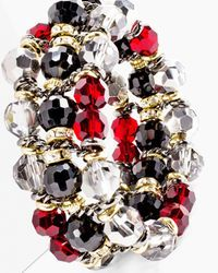 Estelle Stretch Bracelet $39. Deeply captivating. This layered stretch bracelet brings new depth to your wardrobe in a high-contrast palette of faceted beads. Stretch design.