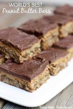 World's BEST Peanut Butter Bars Perfectly thick, soft and chewy peanut butter bars with a peanut butter and chocolate glaze, and oats baked in the chewy cookie bars. Best Peanut Butter, Peanut Butter Desserts, Köstliche Desserts, Delicious Desserts, Dessert Recipes, Peanut Butter Oatmeal Bars, Bar Recipes, Cream Recipes, Healthy Desserts