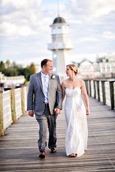 """Newlyweds enjoy a stroll after saying """"I do"""" at Disney's Yacht & Beach Club Resort"""