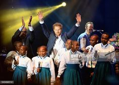 Prince Seeiso of Lesotho, Prince Harry and Chris Martin on stage with the Basotho Youth Choir at the finale of the Sentebale Concert at Kensington Palace on June 28, 2016 in London, England....