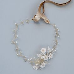 Delicate pearl floral bridal hair vine with gold ribbon by Glass Oyster Accessories