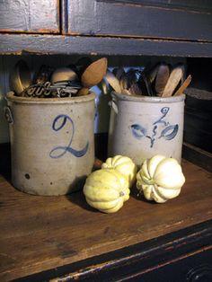 Crocks...and old wooden utensils.