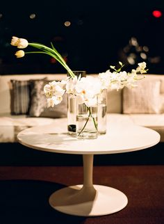 White orchids and tulips for the coffee table
