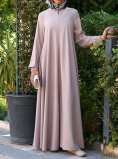 You asked for it, and we are happy to oblige: Finally, a wrinkle-resistant version of our popular abayas! The name says it all, and it's as easy to wear as it is to care for. Elasticized sleeves, a front opening, and the perfect flattering, feminine flair work together to create one beautiful, practical piece you'll be reaching for day after day. Abaya Fashion, Muslim Fashion, Long African Dresses, Modern Abaya, Abaya Designs, Muslim Dress, Islamic Clothing, Casual Work Outfits, Occasion Dresses