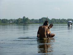 Boys in canoe on Dal Lake, Kashmir