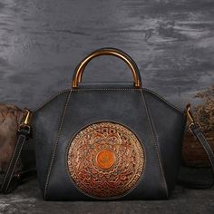 b98f7161180f Gorgeous and unique, this genuine leather handbag features an intricate  stamped mandala design on the