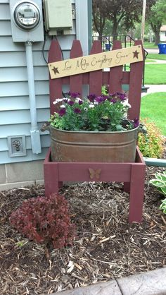 How cute is this?! I love the galvanized bucket of flowers. What a great way to deal with those annoying small corners we find in our gardens. Great idea!
