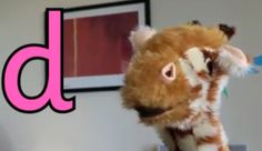 Geraldine Giraffe finds things beginning with the letter d