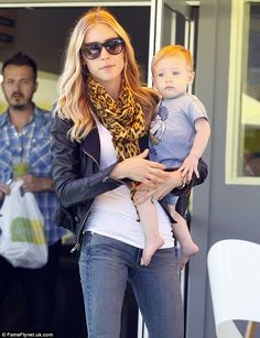 Doting mother: Kristin Cavallari cradled her baby son Mason as she enjoyed an al fresco lunch with friends in West Hollywood on Tuesday