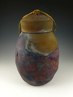 This elegant one-of-a-kind Stone Mountain Raku style companion urn has an aged look and is inspired by forms and textures of the earth. Find it at http://www.artisurn.com/collections/companion-urns/products/stone-mountain-raku-style-companion-urn. #raku #urns #handmade