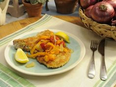 Pickle Schnitzel-Pickle-Brined Pork Chops with Sweet and Spicy Peppers recipe from Jeff Mauro via Food Network
