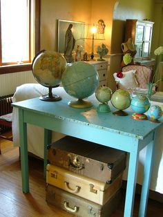 Globes and suitcases.